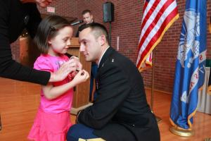 LT Garza receives his bar from his daughter