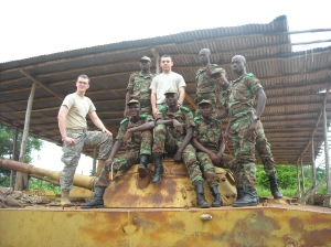 Benin Army Cadets and my teaching partner Brad Fratangelo (Pennsylvania State University) on top of a training tank.