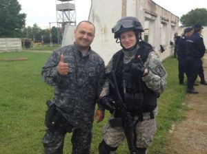 My Romanian counterpart (Cioby) and me wearing the riot control equipment